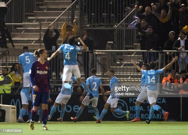UD Ibiza's players celebrates a goal scored by Ibiza's Spanish midfielder Josep Caballe during the Copa del Rey football match between UD Ibiza and...