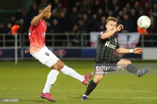 Ibou Touray of Salford City FC is closed down by Sam Hoskins of Northampton Town FC during the Sky Bet League 2 match between Salford City and...