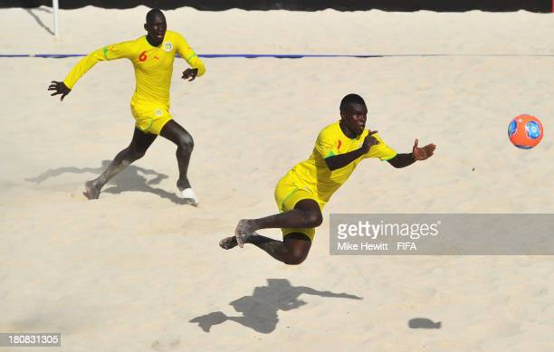 Ibra Thioune and Ibrahima Balde of Senegal in action during a training session at the To'ata Stadium on September 16, 2013 in Papeete, French...