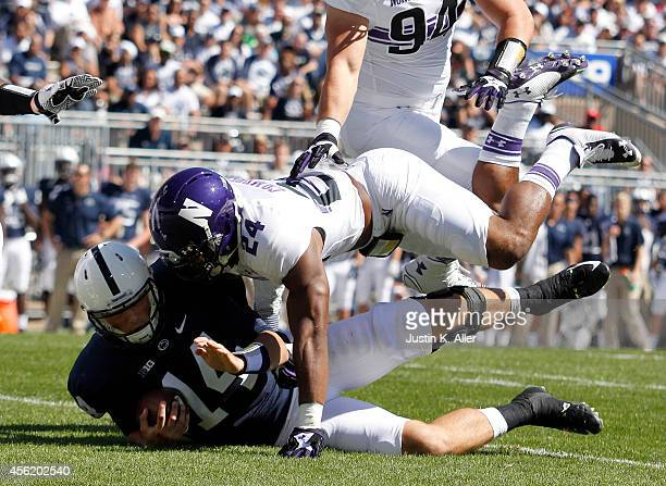 Ibraheim Campbell of the Northwestern Wildcats tackles Christian Hackenberg of the Penn State Nittany Lions in the first half during the game on...