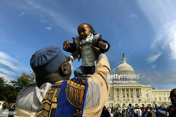 Ibrahim AbdulHaqq plays with his grandson Zuhayr Boyer both of Newark New Jersey following a Jumah prayer where several thousand muslims gathered to...