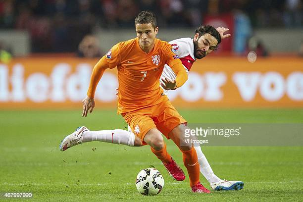 Ibrahim Afellay of Holland Selcuk Inan of Turkye during the UEFA Euro 2016 qualifying match between Netherlands and Turkey on March 28 2015 at the...