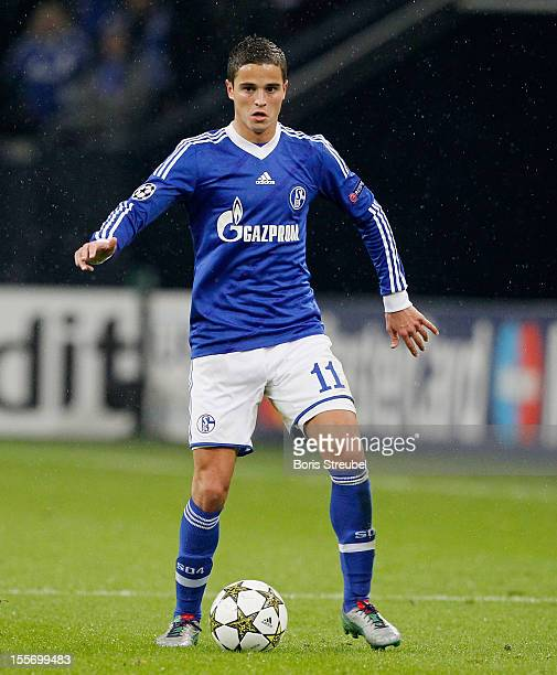 Ibrahim Afellay of Schalke runs with the ball during the UEFA Champions League group B match between FC Schalke 04 and Arsenal FC at VeltinsArena on...