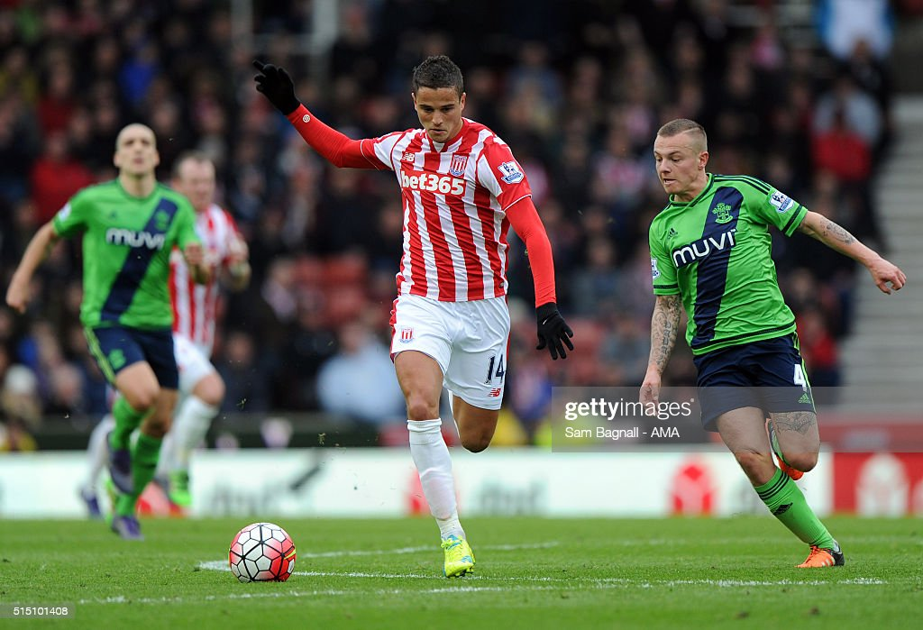 Ibrahim Afellay of Stoke City and Jordy Clasie of Southampton during the Barclays Premier League match between Stoke City and Southampton at Britannia Stadium on March 12, 2016 in Stoke on Trent, England.