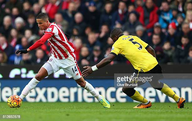 Ibrahim Afellay of Stoke City and Jores Okore of Aston Villa compete for the ball during the Barclays Premier League match between Stoke City and...