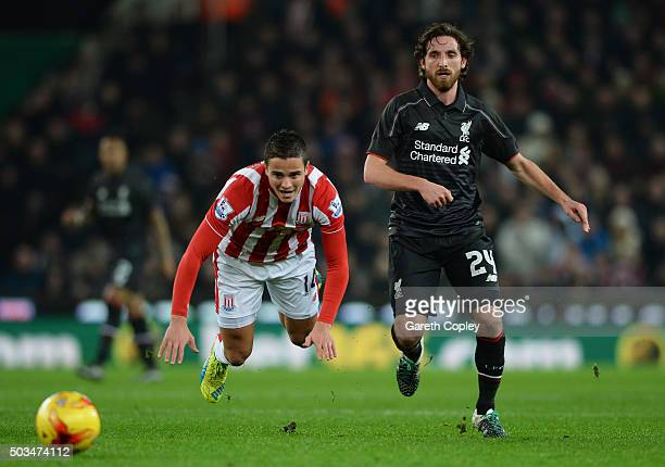 Ibrahim Afellay of Stoke City is brought down by Joe Allen of Liverpool during the Capital One Cup semi final first leg match between Stoke City and...