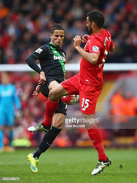 Ibrahim Afellay of Stoke City is challenged by Kevin Stewart of Liverpool during the Barclays Premier League match between Liverpool and Stoke City...