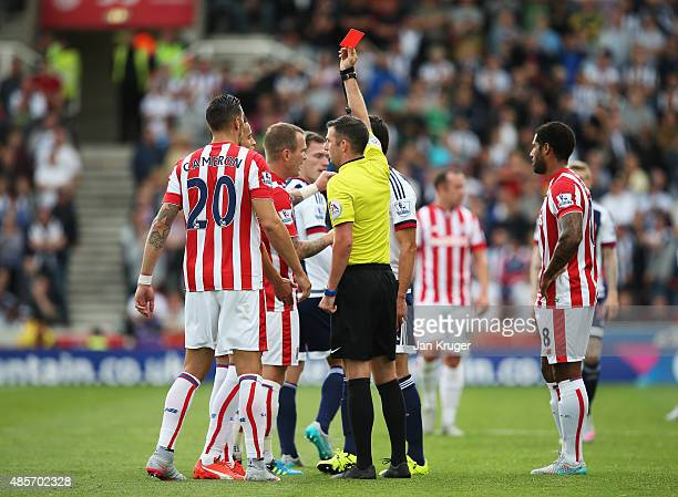 Ibrahim Afellay of Stoke City is shown a red card by referee Michael Oliver during the Barclays Premier League match between Stoke City and West...
