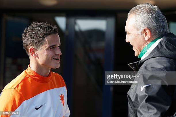 Ibrahim Afellay of the Netherlands speaks to former Bulgarian footballer Hristo Stoichkov during the Netherlands Training session held at the Quick...
