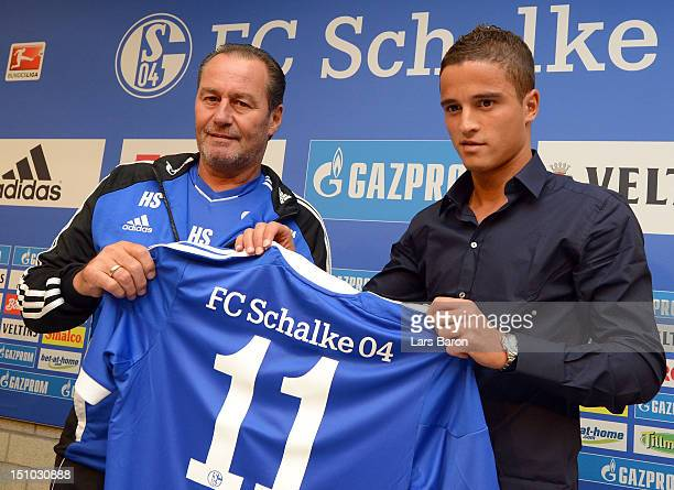 Ibrahim Afellay poses with head coach Huub Stevens after a press conference at the Veltins Arena on August 31 2012 in Gelsenkirchen Germany