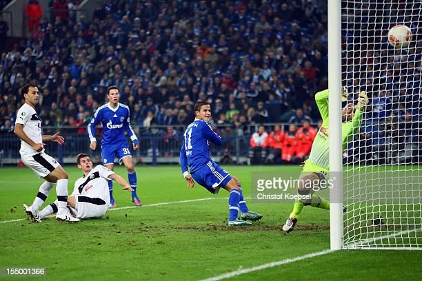 Ibrahim Affelay of Schalke scores the first goal against Daniel Ischdonat of Sandhausen during the DFB Cup second round match between FC Schalke 04...