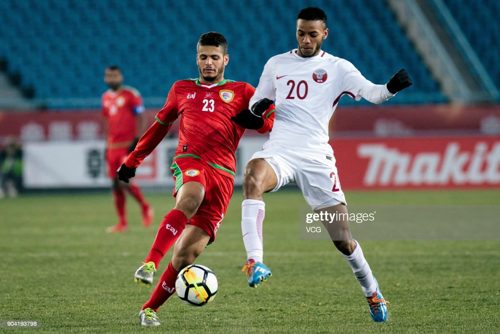 Ibrahim Al Sawwafi #23 of Oman and Salem Al Hajri #20 of Qatar compete for the ball during the AFC U-23 Championship Group A match between Oman and Qatar at Changzhou Olympic Sports Center on January 12, 2018 in Changzhou, Jiangsu Province of China.