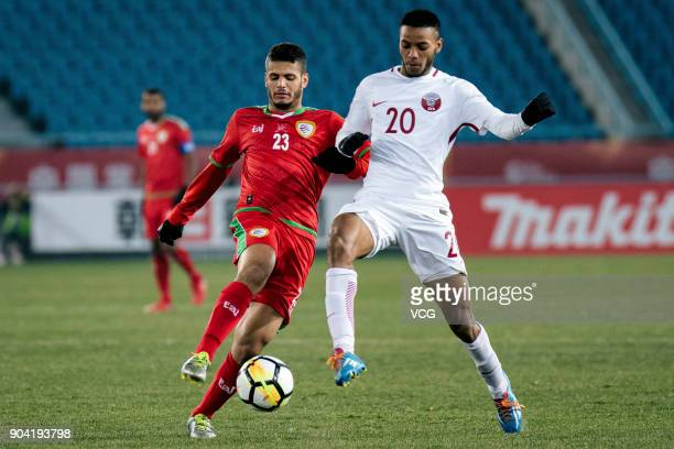 Ibrahim Al Sawwafi of Oman and Salem Al Hajri of Qatar compete for the ball during the AFC U23 Championship Group A match between Oman and Qatar at...