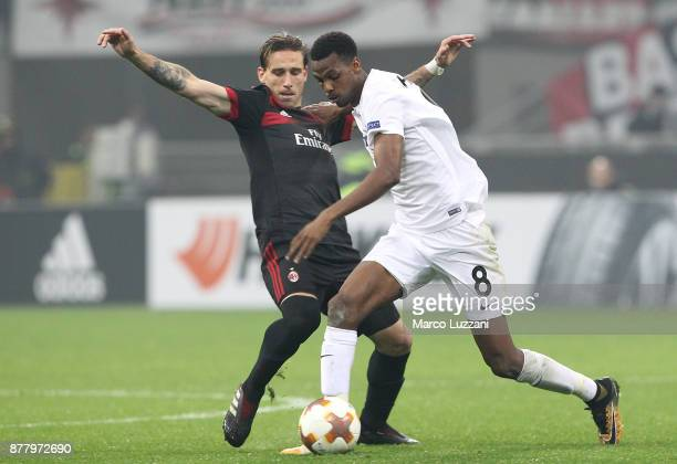 Ibrahim Alhassan Abdullahi of Austria Wien competes for the ball with Lucas Biglia of AC Milan during the UEFA Europa League group D match between AC...
