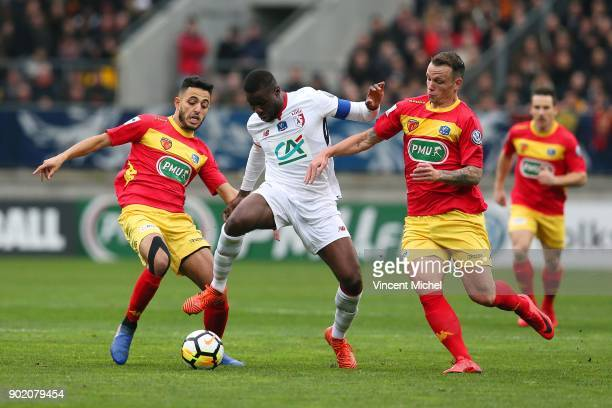 Ibrahim Amadou of Lille and Hamza Hafidi and Nicolas Suchet of Le Mans during the french National Cup match between Le Mans and Lille on January 6...