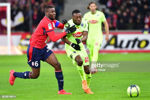 Ibrahim Amadou of Lille and Karl Toko Ekambi of Angers during the Ligue 1 match between Lille OSC and Angers SCO at Stade Pierre Mauroy on February...