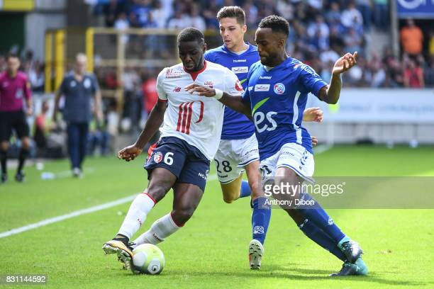 Ibrahim Amadou of Lille Jonas Martin and Yoann Salmier of Strasbourg during the Ligue 1 match between Racing Club Strasbourg and Lille OSC at Stade...