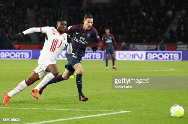 Ibrahim Amadou of Lille OSC in action with Julian Draxler of Paris SaintGermain in action during the Ligue 1 match between Paris Saint Germain and...