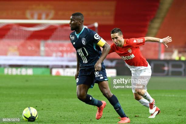 Ibrahim Amadou of Lllle and Joao Moutinho of Monaco during the Ligue 1 match between AS Monaco and Lille OSC at Stade Louis II on March 16 2018 in...