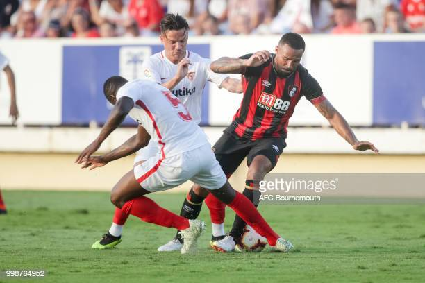 Ibrahim Amadou of Sevilla and Callum Wilson of Bournemouth during the preseason friendly between AFC Bournemouth and Sevilla at La Manga Club...