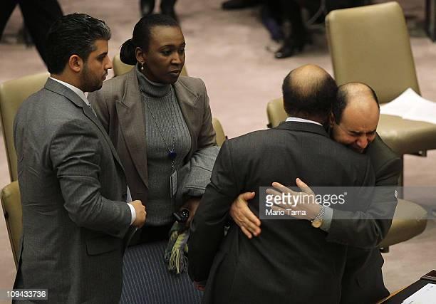 Ibrahim Dabbshi, Libya's Deputy UN Ambassador hugs Abdurraham Mohamed Shalgam , Libya's United Nations ambassador, after Shalgam denounced Libyan...