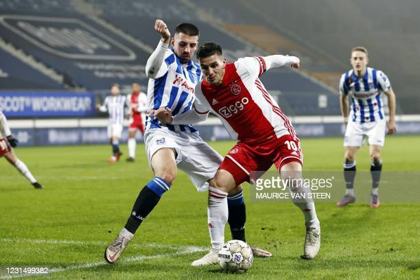 Ibrahim Dresevic of sc Heerenveen fights for the ball with Dusan Tadic or Ajax during the KNVB Cup semi-final match between sc Heerenveen and Ajax...