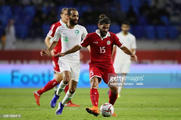 Ibrahim Ghaleb of Lebanon competes with Abdullah Otayf of Saudi Arabia during the AFC Asian Cup Group E match between Lebanon and Saudi Arabia at Al...