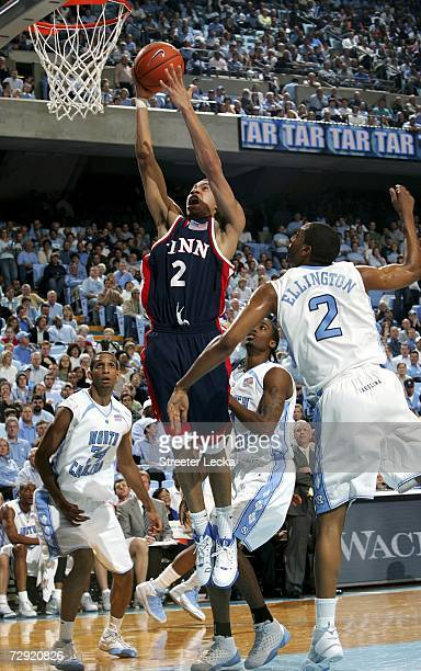 Ibrahim Jaaber of the Pennsylvania Quakers goes to the baset against the defense of the University of North Carolina Tar Heels on January 3 2006 at...