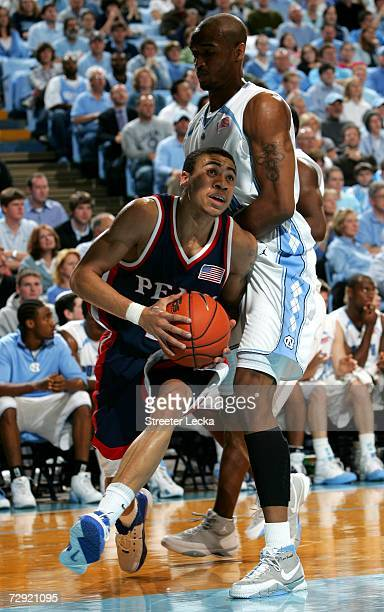 Ibrahim Jaaber of the Pennsylvania Quakers goes to the basket against Reyshawn Terry of the University of North Carolina Tar Heels on January 3 2006...