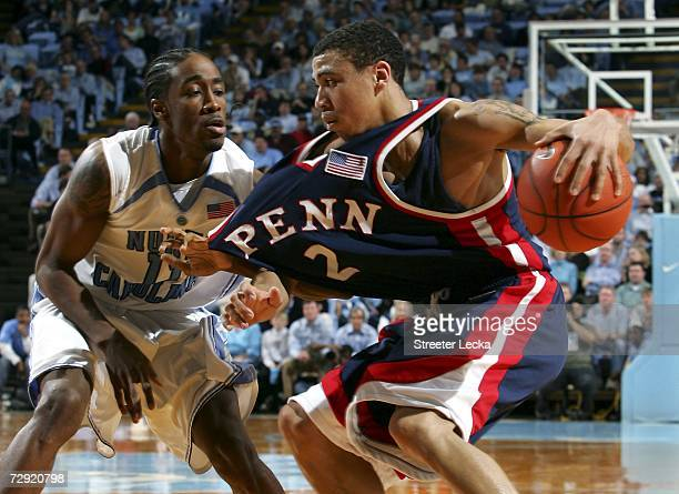 Ibrahim Jaaber of the Pennsylvania Quakers has his jersey pulled by Quentin Thomas of the University of North Carolina Tar Heels on January 3 2006 at...