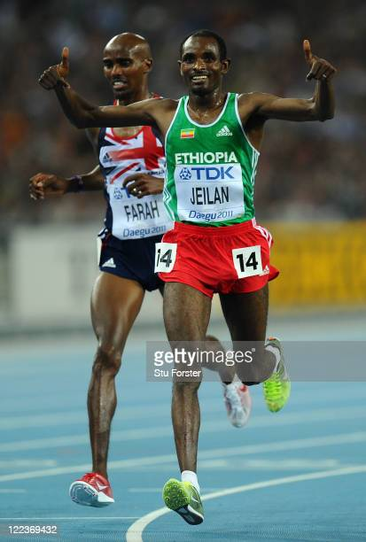 Ibrahim Jeilan of Ethiopia celebrates after passing Mohamed Farah of Great Britain to win the men's 10000 metres final during day two of the 13th...