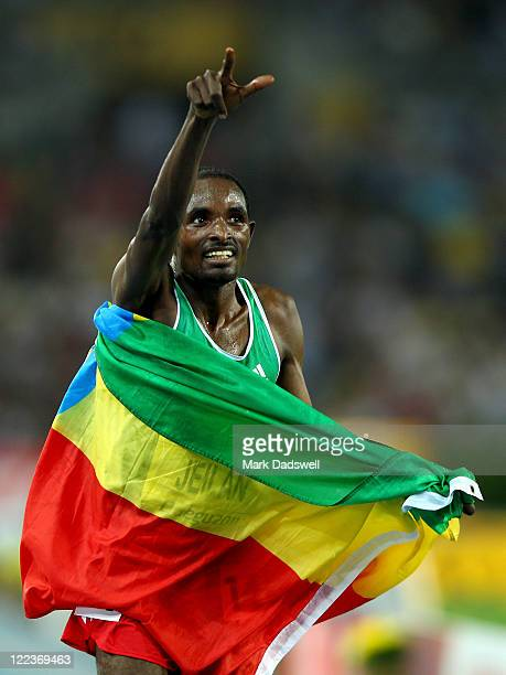 Ibrahim Jeilan of Ethiopia celebrates after winning the men's 10,000 metres final during day two of the 13th IAAF World Athletics Championships at...