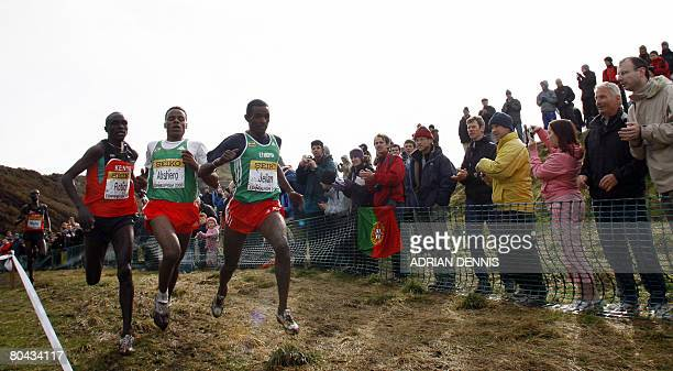 Ibrahim Jeilan of Ethiopia leads fellow countryman Ayele Abshero and Lucas Kimeli Rotich of Kenya downhill during the Junior Men's cross country race...