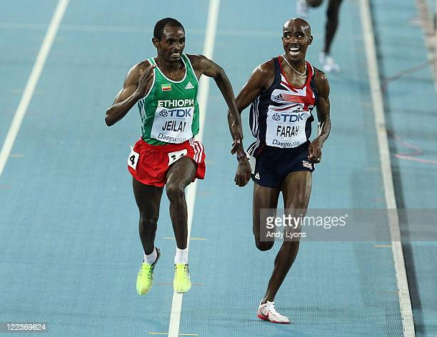 Ibrahim Jeilan of Ethiopia passes Mohamed Farah of Great Britain on his way to winning the men's 10,000 metres final during day two of the 13th IAAF...