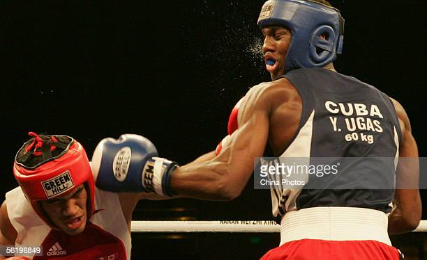 Ibrahim Kamal of Canada fights against Yordanis Ugas Hernandez of Cuba during the 60kg category preliminary match of 13th World Senior Boxing...