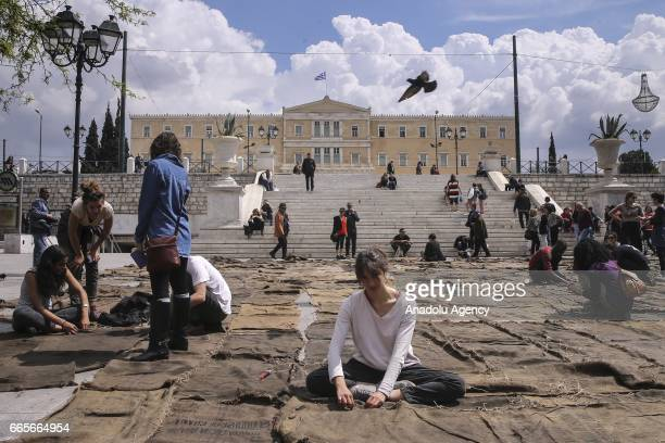 Ibrahim Mahama's performance 'Check Point Prosfygika' is displayed at Syntagma Square within the 14th edition of the art exhibition Documenta in...