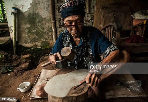 Ibrahim making shadow puppets in Wukirsari Imogiri Bantul Yogyakarta Indonesia on May 23 2016 Shadow puppets are made of buffalo skin an Indonesian...