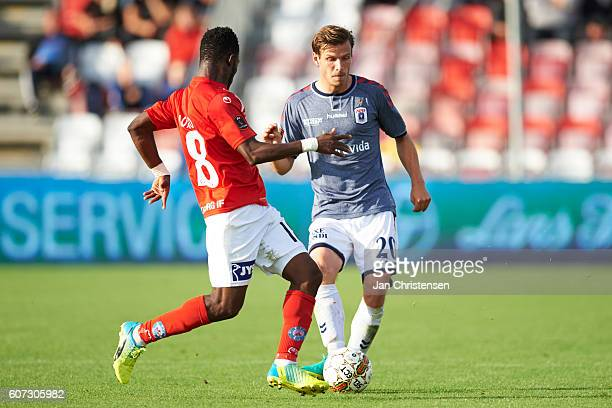 Ibrahim Moro of Silkeborg IF and Elmar Bjarnason of AGF Arhus compete for the ball during the Danish Alka Superliga match between Silkeborg IF and...