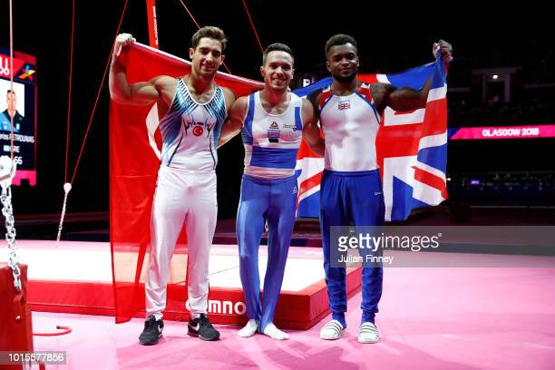 Ibrahim Çolak Eleftherios Petrounias of Greece and Courtney Tulloch pose for a photo after the Men's Rings Gymnastics Final on Day Eleven of the...