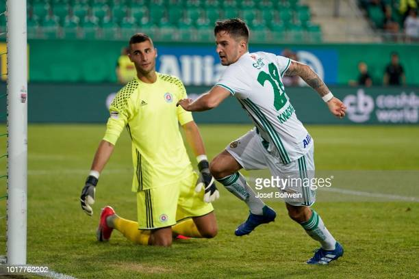 Ibrahim Rabiu of Slovan Bratislava and Christoph Knasmuellner of Rapid go for a header during the UEFA Europa League Third Round Qualifier Second Leg...