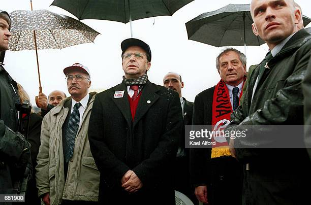 Ibrahim Rugova leader of the LDK stands with fellow party members between security guards during the Kosovo anthem at a preelection rally November 14...
