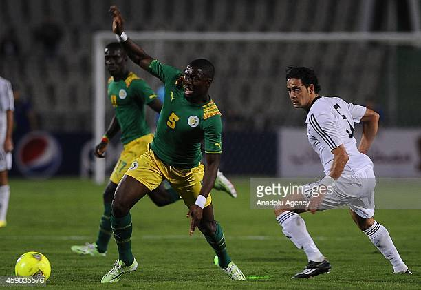 Ibrahim Salah of Egypt in action against Papakouli Diop of Senegal during the Africa Cup of Nations qualification group G match between Egypt and...