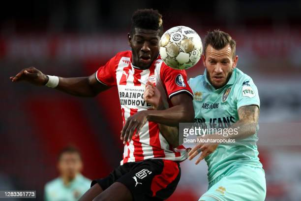 Ibrahim Sangare of PSV battles for the ball with John Goossens of ADO Den Haag during the Dutch Eredivisie match between PSV Eindhoven and ADO Den...