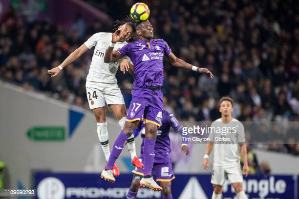 March 31: Ibrahim Sangare of Toulouse and Christopher Nkunku of Paris Saint-Germain challenge for the ball during the Toulouse FC V Paris...