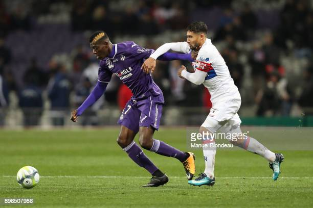 Ibrahim Sangare of Toulouse and Nabil Fekir of Lyon during the Ligue 1 match between Toulouse and Olympique Lyonnais at Stadium Municipal on December...