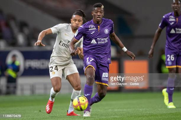 Ibrahim Sangare of Toulouse defended by Christopher Nkunku of Paris SaintGermain during the Toulouse FC V Paris SaintGermain French Ligue 1 regular...