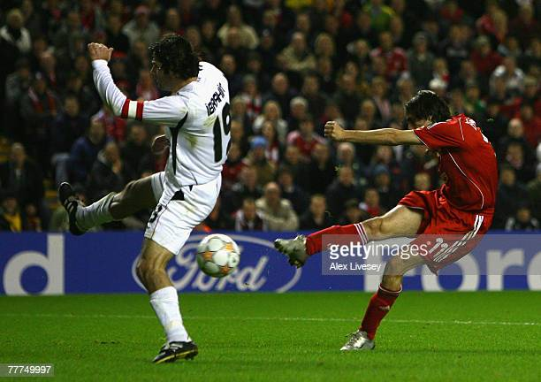 Ibrahim Uzulmez of Besiktas is unable to stop Yossi Benayoun of Liverpool scoring his team's second goal during the UEFA Champions League Group A...