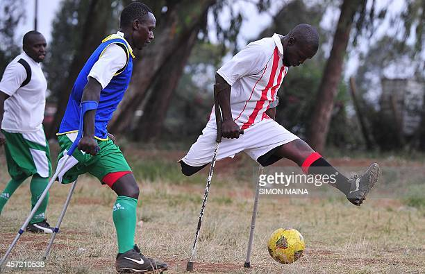 Ibrahim Wafula and Dedan Ireri both players of the Kenyan national amputee football team take part in a training session at the Pangani grounds on...