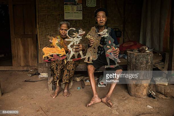 Ibrahim with his wife Rugiyem show shadow puppets in Wukirsari Imogiri Bantul Yogyakarta Indonesia on May 23 2016 Shadow puppets are made of buffalo...