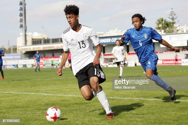 Ibrahim Yassin of Germany in action against Schiro Thomas of Italy during International Friendly between U18 Germany and U18 Italy at Ammochostos...
